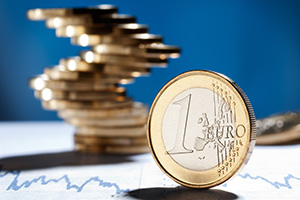 Euro coins stacked on top of charts