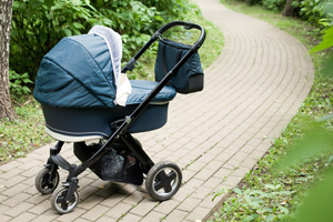 Green pushchair on path