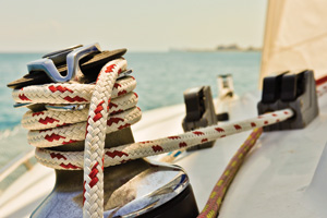 Sailing boat ropes wrapped around winch