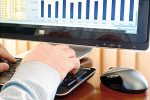 Man working with data and charts on computer