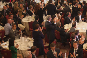 People clapping at the Adam Smith Awards