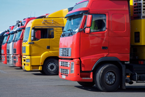 Front of red and yellow lorries