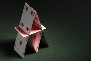 House of cards on green casino table