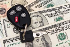 Car keys on top of dollar notes