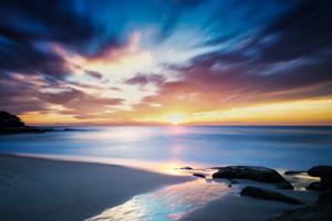 Sunset over the calm sea creating beautiful sky