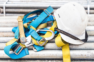 Construction safety equipment such as a hard hat and harness
