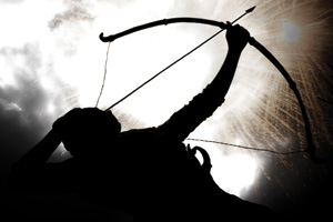 Silhouette of an archer taking aim