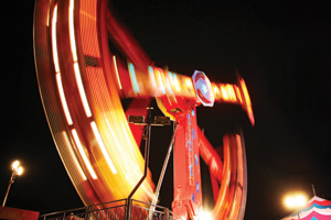 Fairground ride at night with all the lights