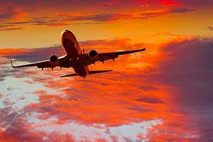 Passenger jet plane flies above the clouds.