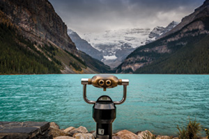 Coin operated binoculars looking over lake in national park, Canada