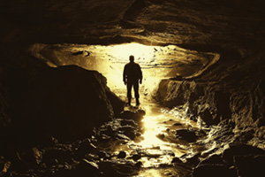 Man standing in a dark cave