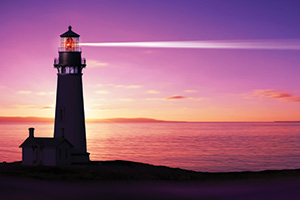 Lighthouse at dusk with searchlight beaming