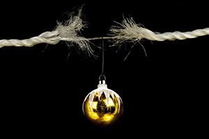 Christmas baul baul hanging off an almost broken rope