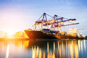 Trade ship leaving the docks at dusk