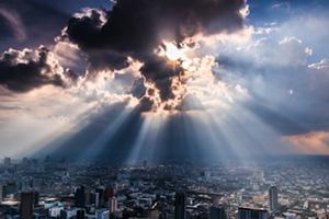 Sun bursting through the dark clouds