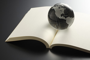 Glass globe on top of an open notebook