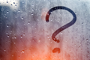 Question mark in a foggy window