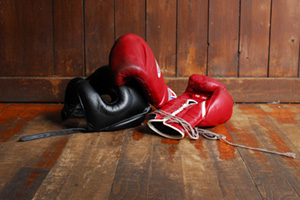 Red boxing gloves and black helmet