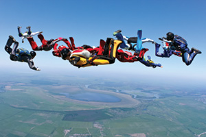 Group of skydivers falling through the air