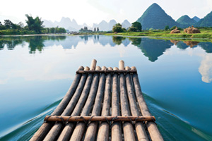 Wooden raft floating on still lake