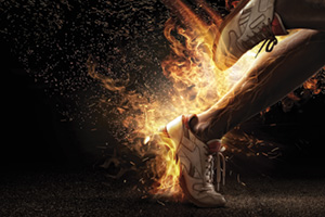 Runner sprinting with legs on fire symbolising power