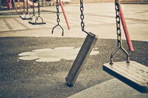 Broken swing on a swing set in park