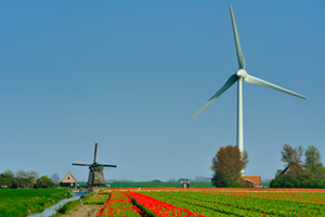 Old windmill and new wind turbine in the Netherlands