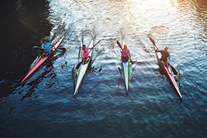 Team of rowers sailing on river