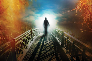 Person crossing old bridge