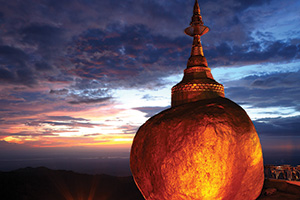 Golden rock in the beautiful twilight Kyaiktiyo Pagoda in Yangon, Myanmar