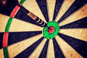 Close up of dart hitting bullseye