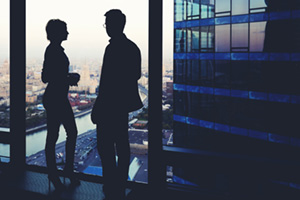 Silhouette of two business people having conversation