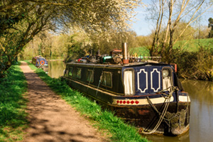 Canal boat moored on a stretch of the grand union canal near Leamington spa