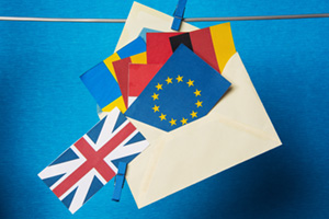 EU paper flags inside a paper envelope and UK outside the envelope