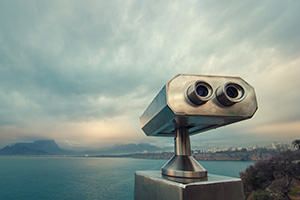 Coin operated binocular viewer looking over the water in Antalya