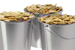 Golden coins in buckets