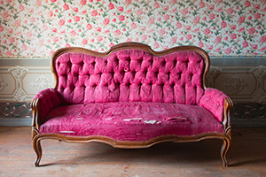 Old damaged pink couch