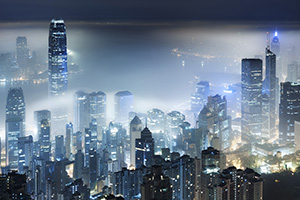 Misty view of Victoria Harbor in Hong Kong city