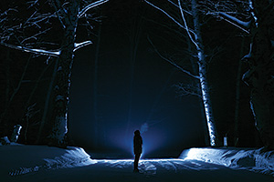 Person in the woods on a cold winters night