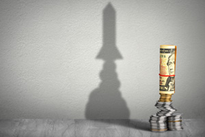 Financial growth concept, dollars creating rocket shadow