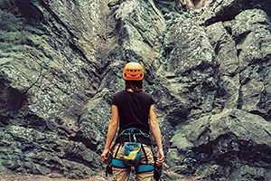 Woman rock climber looking at her next challenge