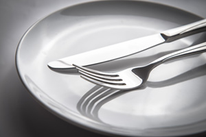 Knife and fork rested on a plate