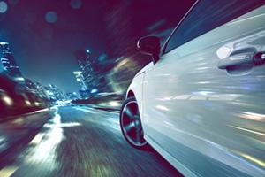 Car speeding towards the city