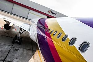 Looking down the length of a THAI Airways jet from nose the front