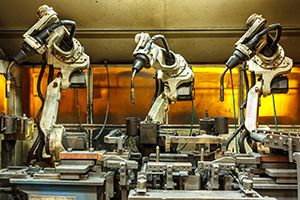 Automated automotive robot welding arms