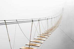 Rope bridge vanishing in fog