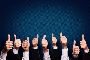 Business people with their thumbs up