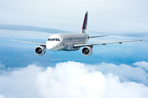 Passenger jet air plane flying over clouds