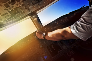 Airliner pilot at work in the cockpit