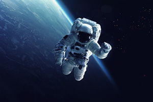 Astronaut space walking above earth